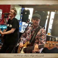 Photo taken at Pure Pop Records by Carbie W. on 4/20/2013