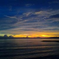 Photo taken at Pantai Candidasa by Margita R. on 2/3/2013