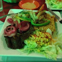Photo taken at D'Mangu Restaurant by Ella L. on 10/12/2012