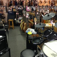 Photo taken at Charlie's Music by Cait O. on 12/16/2012