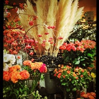 Photo taken at Aoyama Flower Market by Torao T. on 9/19/2013