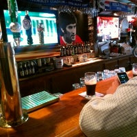 Photo taken at Mulligan's Pub by Christopher M. on 9/19/2012