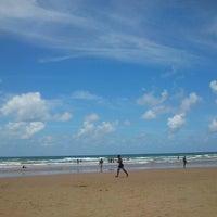Photo taken at Praia de Ipitanga by Rafaela N. on 3/3/2013
