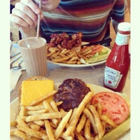 Photo taken at International Delight Cafe by Kim on 4/6/2014