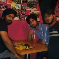Photo taken at V Spot Bar + Cafe by Harpreet S. on 9/19/2012