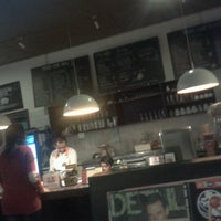 Photo taken at Potluck Kitchen by Farah C. on 2/14/2013