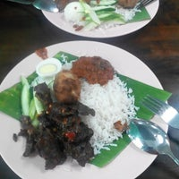 Photo taken at Ujang Corner Nasi Lemak Special BBS by Matt M. on 10/30/2014