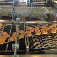 Photo taken at Krispy Kreme Doughnuts by Lien P. on 5/27/2013