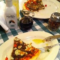 Photo taken at Italianni's Pasta, Pizza & Vino by Marianne B. on 2/8/2013