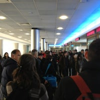 Photo taken at Gate 218 by Mario C. on 4/2/2013