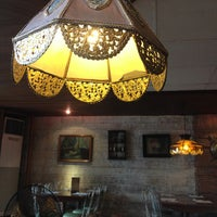 Photo taken at Grilla Bar and Grill by Alice P. on 6/30/2013