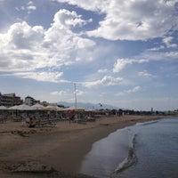 Photo taken at Rethymno Beach by Alexander M. on 10/15/2012