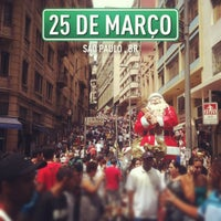 Photo taken at Rua 25 de Março by Nando A. on 12/8/2012