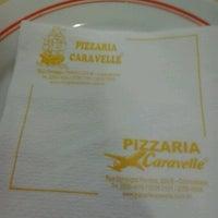 Photo taken at Caravelle Pizzaria by Thiago C. on 11/18/2012
