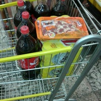 Photo taken at Cometa Supermercados by Adriano N. on 10/11/2012