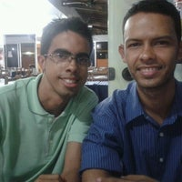 Photo taken at Pizzaria Garoa Paulista by André M. on 9/21/2012