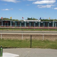 Photo taken at Suffolk Downs by Jason T. on 6/8/2013