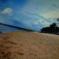 Photo taken at Pantai Ujung Genteng by Ayuniie M. on 5/22/2013
