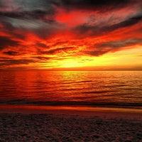 Photo taken at Vanderbilt Beach by Moses H. on 1/11/2013