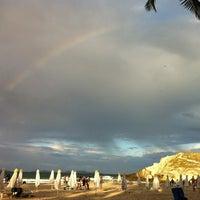 Photo taken at Playa Parguito by Bianca on 2/11/2013