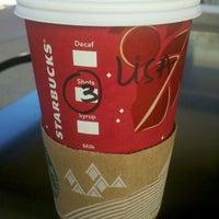 Photo taken at Starbucks by Alissa J. on 12/24/2013