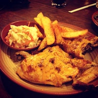 Photo taken at Nando's by Ezra A. on 6/29/2013