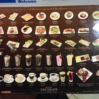 Photo taken at Theobroma Chocolate Lounge by JK on 11/4/2013