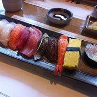 Photo taken at SUSHIMI by kang i. on 8/1/2013