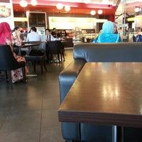 Photo taken at Secret Recipe by Max L. on 12/14/2012