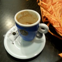Photo taken at COMIC cafe by Anastasia B. on 3/19/2015