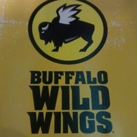 Photo taken at Buffalo Wild Wings by UCPLEASURE on 12/30/2012