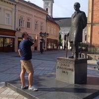 Photo taken at Pozorišni trg by Fk K. on 8/4/2014