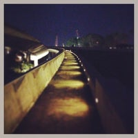 Photo taken at Marina Barrage by Odie A. on 4/12/2013