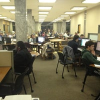 Photo taken at Hesburgh Library by Jian X. on 10/11/2012