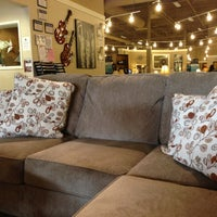 Photo taken at Ashley Furniture Home Store by Peter X. on 8/31/2013