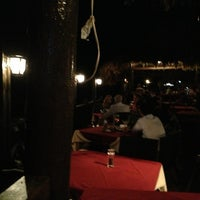 Photo taken at Scampi's Curacao by Ma T. on 3/5/2013