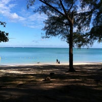 Photo taken at Mont Choisy Beach by Irfan A. on 5/26/2013