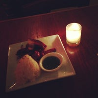 Photo taken at Kuma Inn by Ethan G. on 12/18/2012