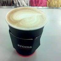 Photo taken at Aroma Espresso Bar by Adella R. on 9/26/2012