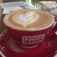 Photo taken at Augie's Coffee Roasters by Robert K. on 12/11/2016