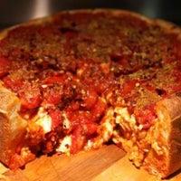 Photo taken at Lou Malnati's Pizzeria by Travis C. on 4/14/2013