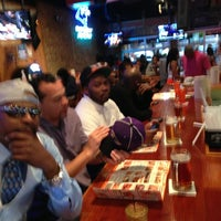 Photo taken at Hooters by Larry T. on 3/2/2013