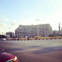 Photo taken at Tahrir Square by Mostafa B. on 10/5/2012