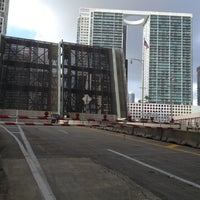 Photo taken at Brickell Ave Bridge by Claudia on 8/6/2013
