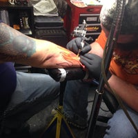 Photo taken at Dragon's Den Tattoo by Torrie S. on 3/28/2015