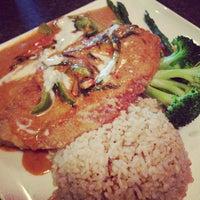 Photo taken at Mango Thai Cuisine by Carmen H. on 5/11/2013