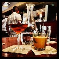 Photo taken at Flora Restaurant & Bar by yoshio s. on 5/31/2013