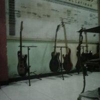 Photo taken at Kabin Studio Rock Shop & Dagelan by Wahyu F. on 3/20/2013