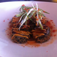 Photo taken at Reiki Sushi & Asian Bistro by Regine C. on 10/13/2012