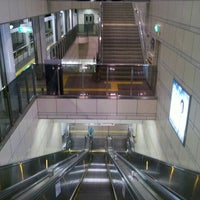 Photo taken at Cosmosquare Station by moni9999 on 10/5/2012